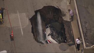 Parked car swallowed up by sinkhole