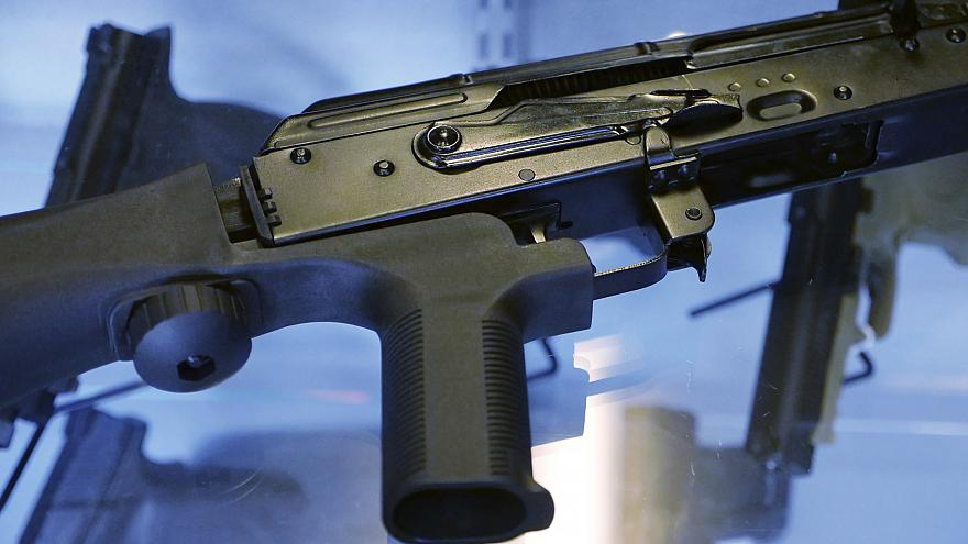 Image: A bump stock is attached to a semi-automatic rifle at store and gun
