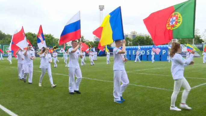 Children mingle and dream big at 'Football for friendship' tournament