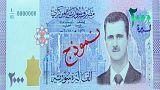 چاپ تصویر بشار اسد روی اسکناس های سوری