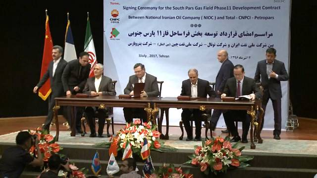 Total re-invests in Iran