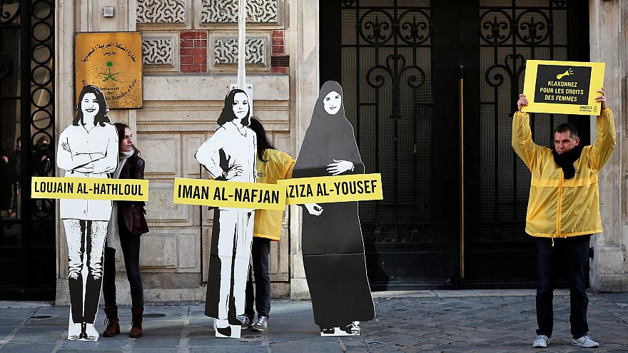 Image: Demonstrators from Amnesty International protest outside the Saudi A