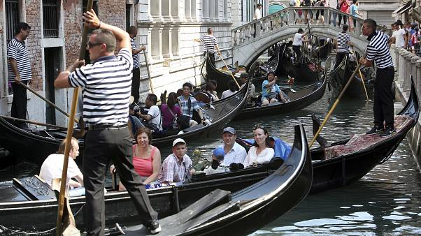 Venetians hold protest against tourist influx