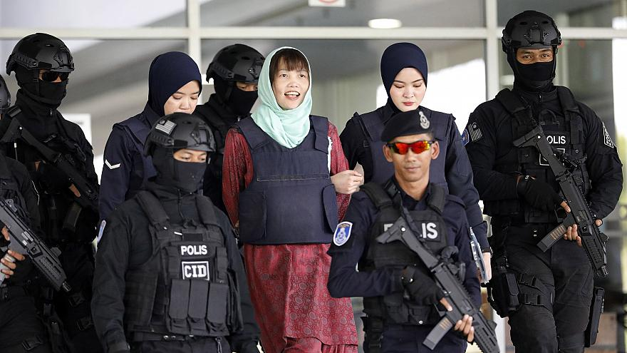 Image: Vietnamese Doan Thi Huong, center, is escorted by police as she leav