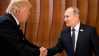 Watch: Trump and Putin shake hands during first face-to-face meeting