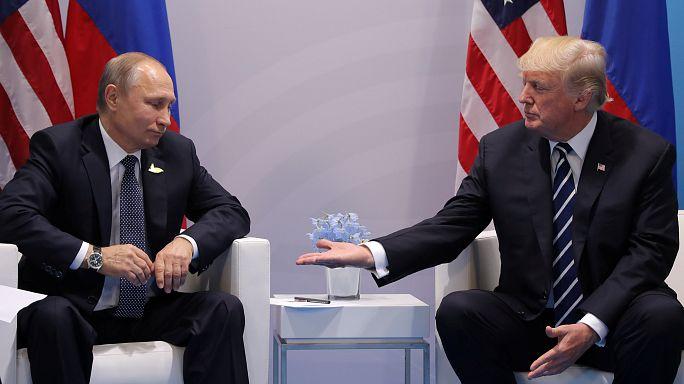 Первая встреча Путина и Трампа