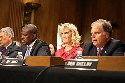 Sen. Doug Jones, D-Ala., introduces Alabama native Lynda Blanchard, the nominee for Ambassador to Slovenia, to the Senate Foreign Relations Committee on Aug. 16, 2018.