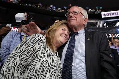 Bernie Sanders embraces his wife Jane O\'Meara Sanders after the Vermont delegation cast their votes during roll call on the second day of the Democratic National Convention at the Wells Fargo Center on July 26, 2016 in Philadelphia, Pennsylvania.
