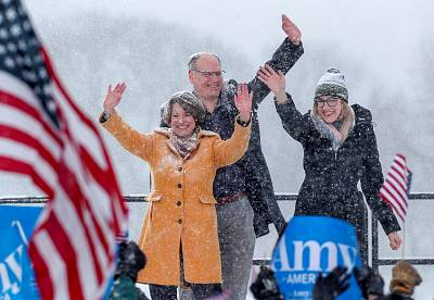 Amy Klobuchar waves to the crowd with her husband John Bessler and daughter Abigail Bessler after announcing her candidacy for the 2020 Democratic presidential nomination in Minneapolis, Minnesota, on Feb. 10, 2019.