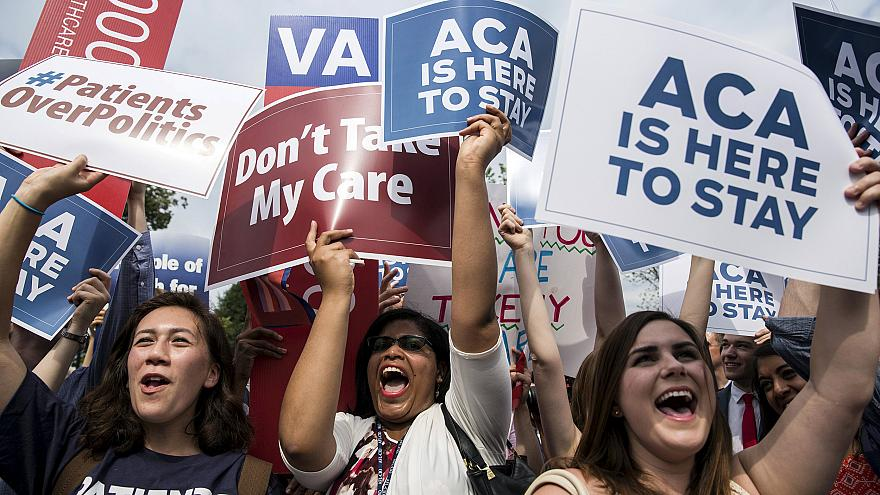 Image:  Supporters of the Affordable Care Act celebrate after the Supreme C