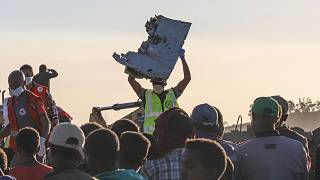 Image: Debris is removed from the crash site of the Ethiopian Airlines jet