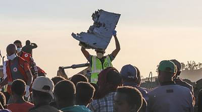 Debris is removed from the crash site of the Ethiopian Airlines jet on March 10.