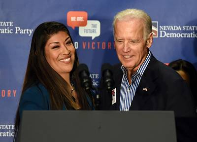 Democratic candidate for lieutenant governor and current Nevada Assemblywoman Lucy Flores, D-Las Vegas, from left, introduces Vice President Joe Biden at a get-out-the-vote rally at a union hall in Las Vegas, Nevada on Nov. 1, 2014.