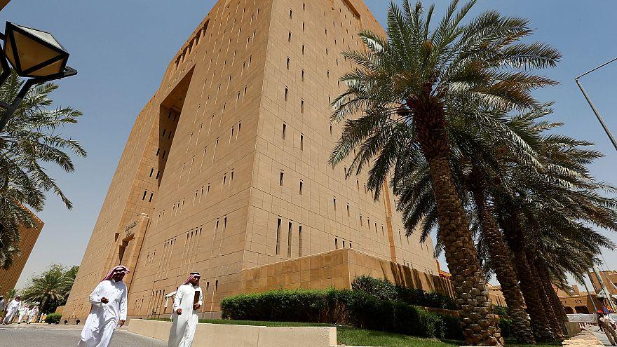 Image: Saudi men walk outside the General Court in Riyadh