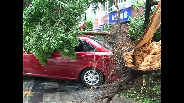 Storms and landslides cause havoc in central and southern China