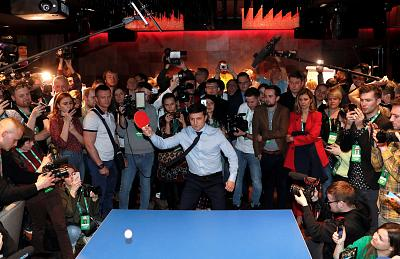 Volodymyr Zelenskiy plays table tennis at his campaign headquarters on Sunday.