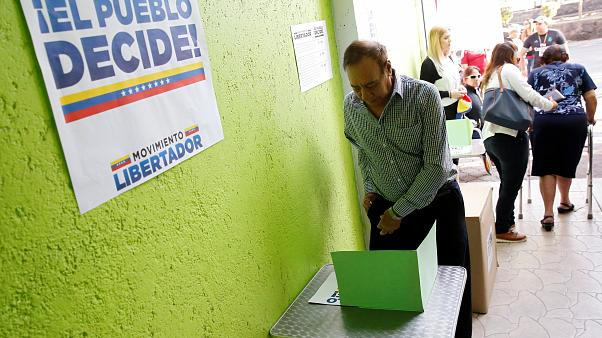 'Shooting at voting centre' as Venezuelan opposition holds unofficial referendum