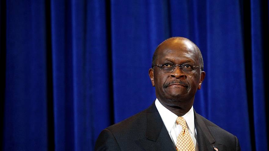 Image: Herman Cain speaks at a press conference in Scottsdale, Arizona, on