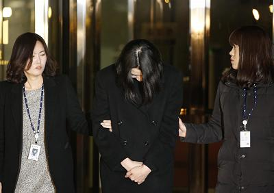 Cho Hyun-ah, the daughter of Korean Air Chairman Cho Yang-ho, after a court hearing in December 2014 in Seoul, South Korea, where she was ordered detained.