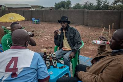 Men drink beer and spirits in a bar in the Nakivale refugee settlement in southwest Uganda. More than 100,000 refugees live in Nakivale, according to the Ugandan government.