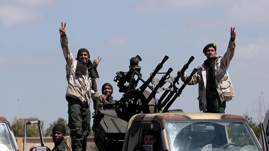 Image: Members of the self-styled Libyan National Army leave Benghazi