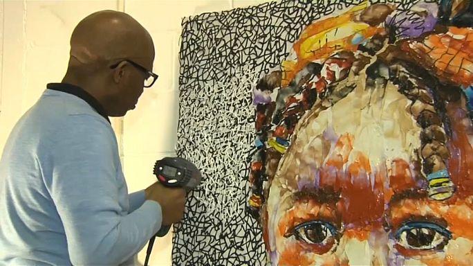 Artist paints in plastic to highlight how branded soft drink bottles litter the environment