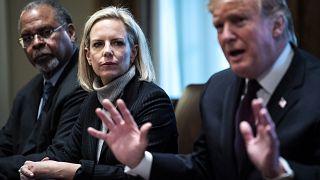 Image: President Donald Trump, flanked by Secretary of Homeland Security Ki