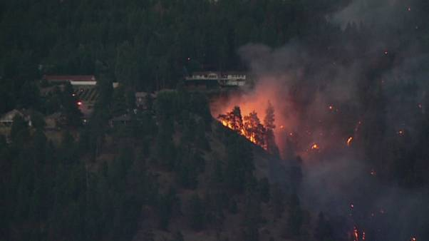 Tens of thousands of people evacuated as wildfires continue to sweep across British Columbia