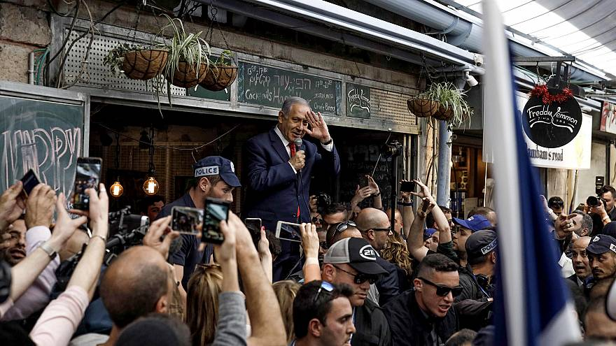 Image: Israeli Prime Minister Benjamin Netanyahu speaks to supporters at th