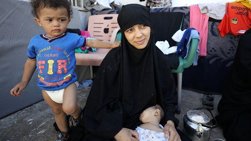 """زوجات مقاتلي داعش يروين قصصهن داخل دولة """"الخلافة"""""""