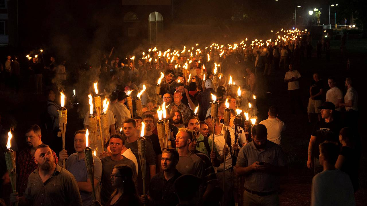 Image: White nationalists carry torches on the grounds of the University of