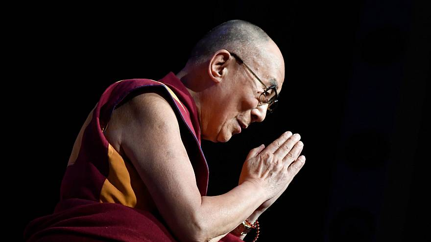 Image: The Dalai Lama gestures during a group hearing in Paris on Sept. 13,