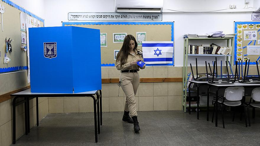 Image: An Israeli soldier votes during the general election in Ashkelon on