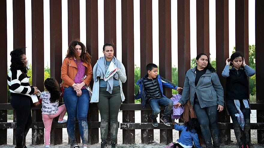 Image: Central American migrants turn themselves in to U.S. Border Patrol a