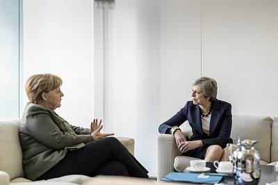 German Chancellor Angela Merkel meets with British Prime Minister Theresa May in Berlin on Tuesday.