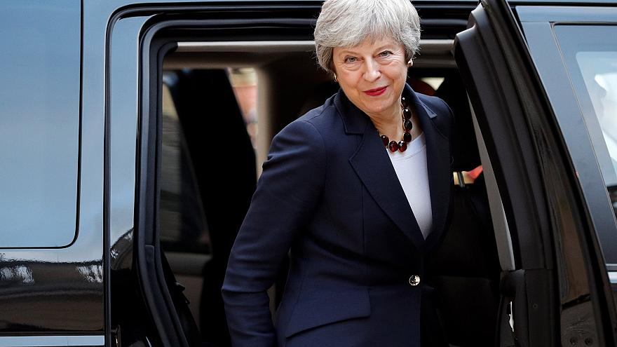 Image: British Prime Minister Theresa May leaves after a meeting with Frenc