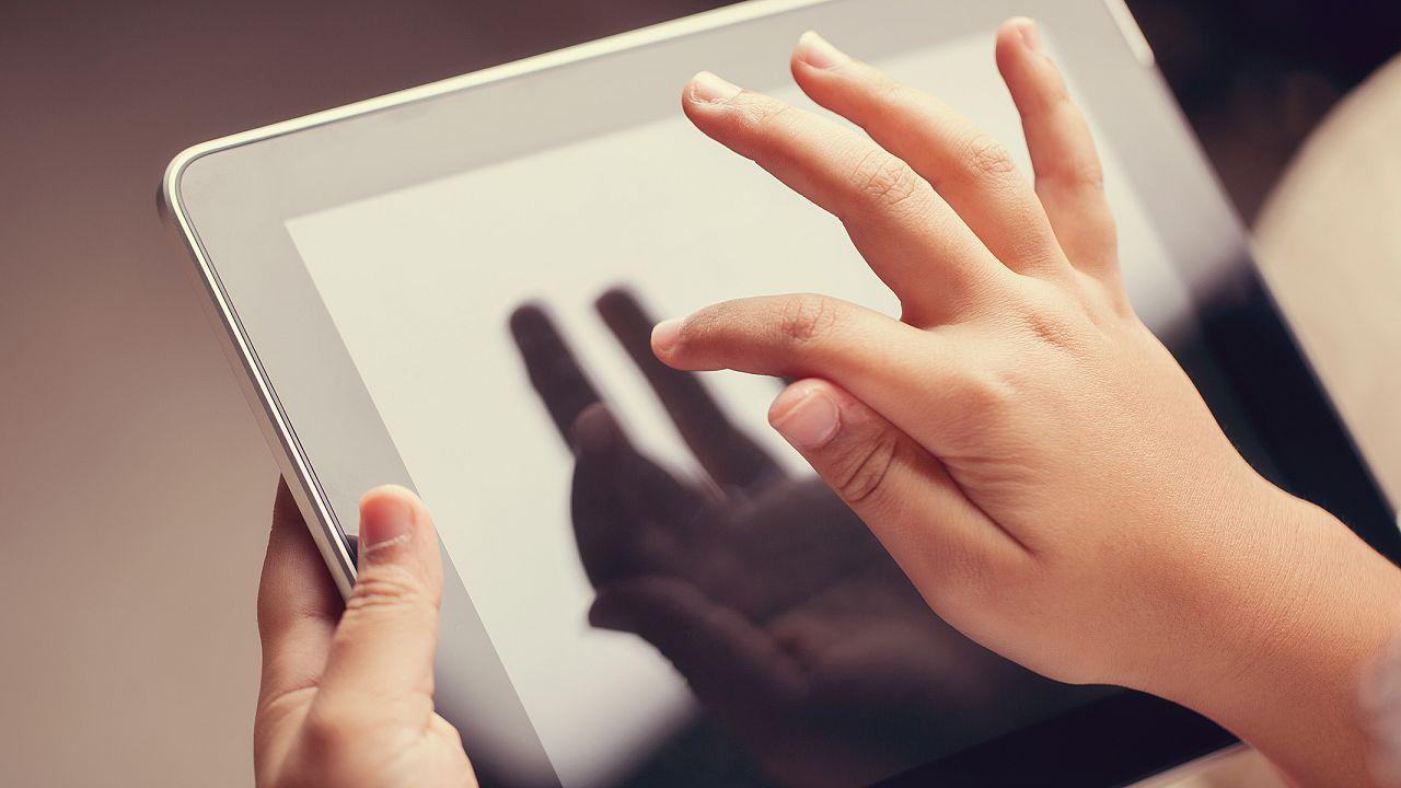 closeup of little boy using digital tablet
