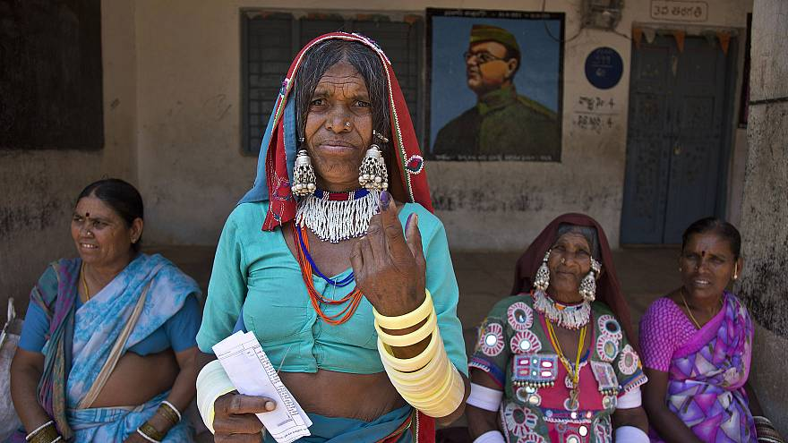 Image: An Indian Lambada tribal woman shows the indelible ink mark on her i