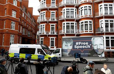 A truck carrying a poster featuring WikiLeaks founder Julian Assange outside the Ecuadorian Embassy in London on Friday.