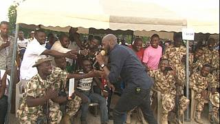 Nigerian soldiers, displaced persons take a break to party with musician Tuface