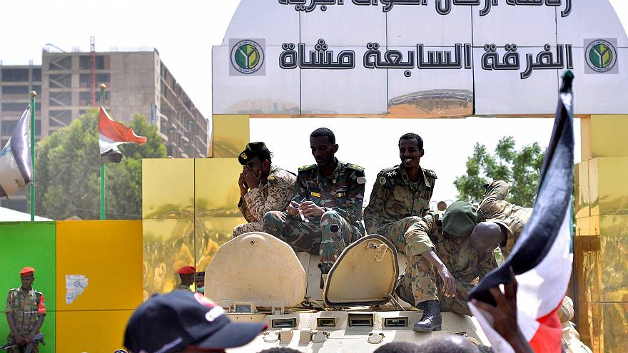 Image: Sudanese military sit on their armoured personnel carrier near the D