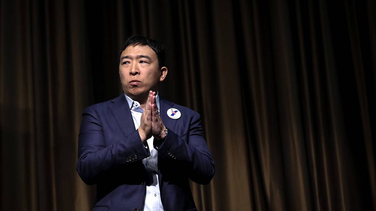 Image: Democratic presidential candidate Andrew Yang exits the stage after
