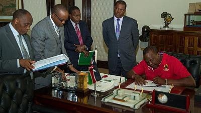 Kenya's president signs 8 bills into law, 18 days to election