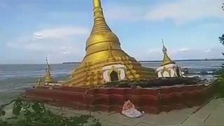 Buddhist pagoda falls into river in Myanmar