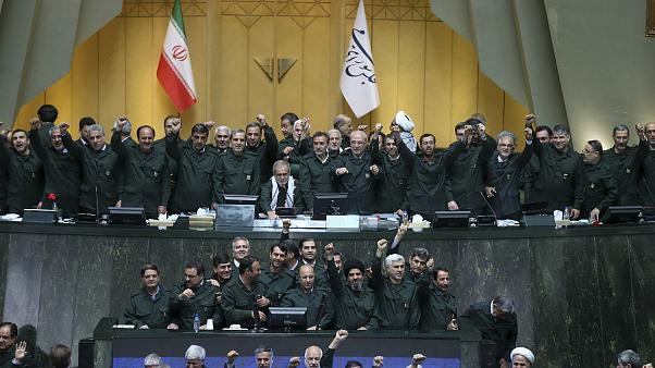 Image: Wearing the uniform of the Iranian Revolutionary Guard, lawmakers ch