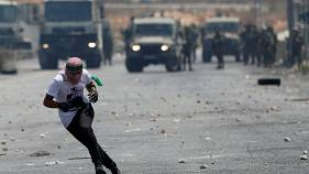 Palestinian protesters and Israeli security forces clash in West Bank