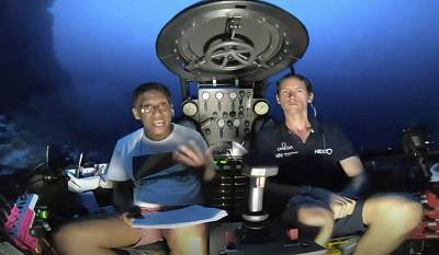 Seychelles President Danny Faure, left, speaks from insider a submersible of the vessel Ocean Zephyr underwater off the coast of Desroches on April 14, 2019.