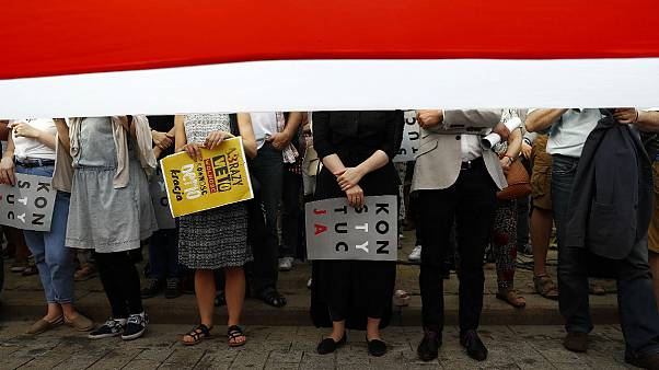 Polish protesters call on Duda to go further over reforms veto
