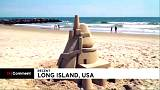Artist travels an hour a day to build sand castles at a Long Island beach