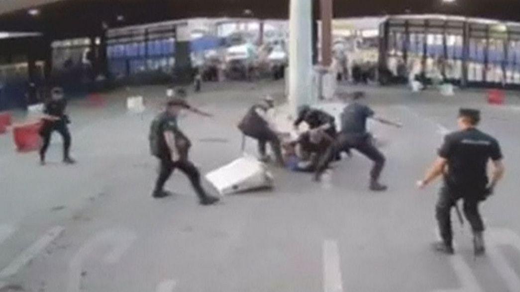 Spanish policeman strikes armed attacker with bollard